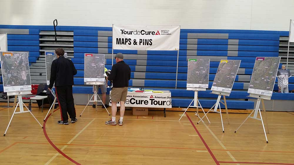 C.T. Male Associates studying the Tour de Cure Maps
