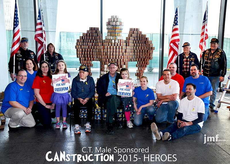 CT Male Associates and Veterans posing in front of 2015 Canstruction entry